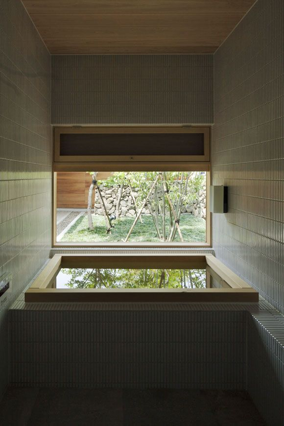 The Art of the Japanese Bath | House in Ichihara  by Yasushi Horibe Architect & Associates.  This very compact bathroom is lined in thin tiles. The small, yet deep, wooden bath looks into a small courtyard.    not a bad view