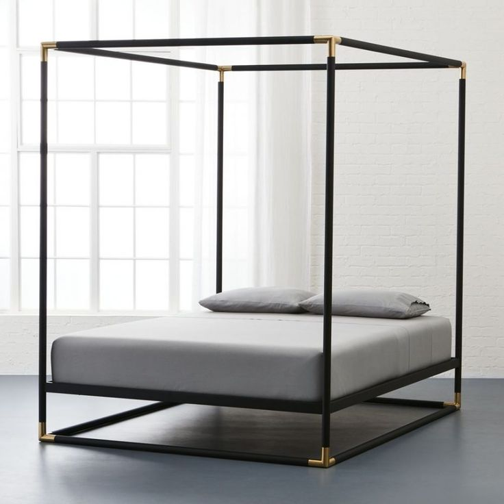 wrought iron canopy bed made of metal in black lacquer finished with gold accentu2026
