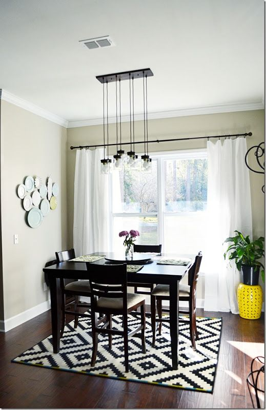 Were Obsessed With This Modern Dining Room The Plates On Wall Are From HomeGoods As Well Yellow Garden Stool Rug Is IKEA