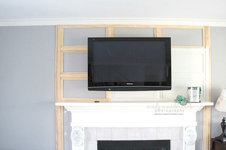 and we are loving how it looks....     the long term plan is to create some built-in shelves on either side of the fireplace. my desk is o...