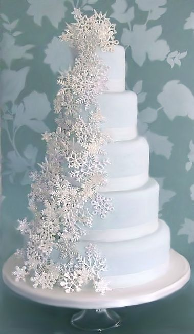 Snowflake cake with a pale frosty blue icing