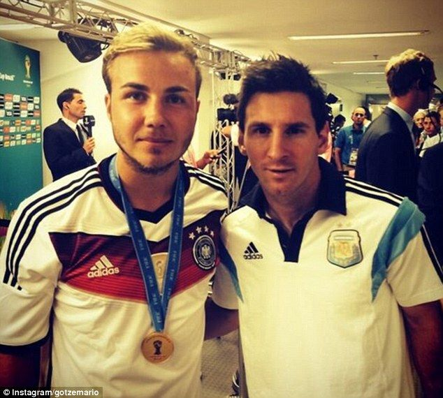Gracious: Messi stops for a photo with Germany's World Cup-winning goal scorer Mario Gotze..that would be hard