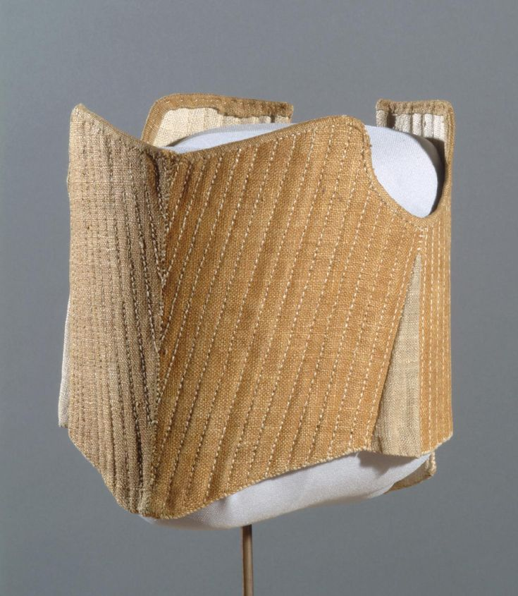 Child's Stays  Artist/maker unknown, American  Geography: Made in United States, North and Central America Date: c. 1770-90 Medium: Linen plain weave, baleen (whalebone), silk braided tape Dimensions: Center Front Length: 5 3/4 inches (14.6 cm) Waist: 18 inches (45.7 cm) Accession Number: 1988-15-1