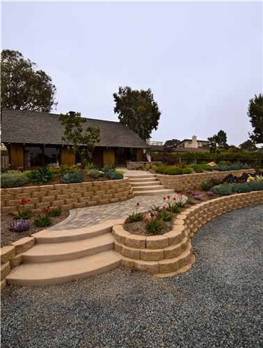 This front yard walkway and entrance make innovative use of a large space. See hundreds more front yard landscaping photos here: http://www.landscapingnetwork.com/pictures/front-yard-landscaping_15/