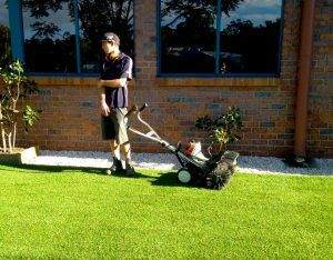 Use power broom to keep your artificial grass clean