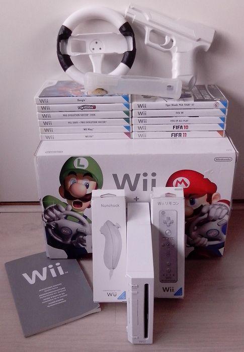 Online veilinghuis Catawiki: Nintendo Wii + 11 games & accessories (Wii Motion Plus, Nunchuck, Sensor bar and more)