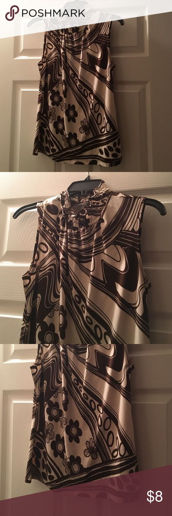 Retro Sleeveless Sere Nade Brown and Cream Top So cute under a jacket with its 80/20 Polyester Spandex blend, it will work well to make you feel a little dressed up with a relaxing casual feel.... must go ;) Sere Nade New York Tops Blouses