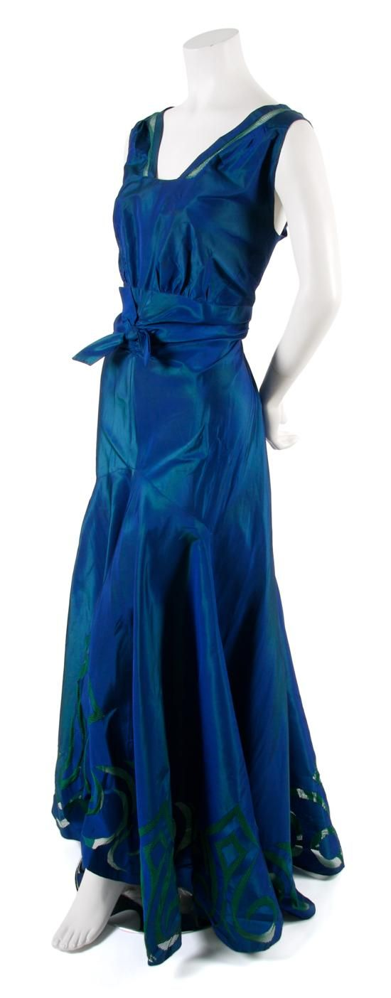 A French Couture Blue Silk Taffeta Dress, probably 1930s, with green mesh cut-aways throughout.  Property from the Collection of Katharine (McLane) Tiffany Abbott, the granddaughter of the founder of Tiffany.