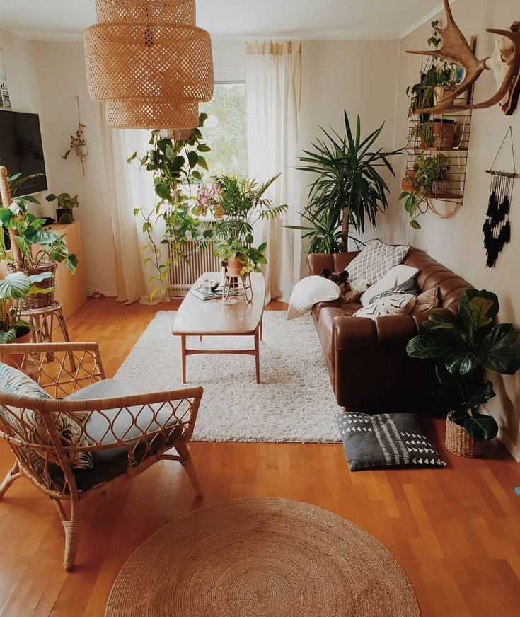 living room   home decor   house decoration   apartment   small space   bohemian   rattan chair   brown leather couch   neutrals   plants   houseplants