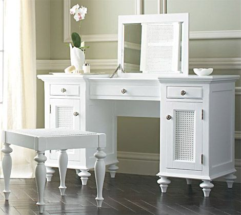 hmm.. i see two skinny cabinets with drawers, add feet, board across top plus mirror...
