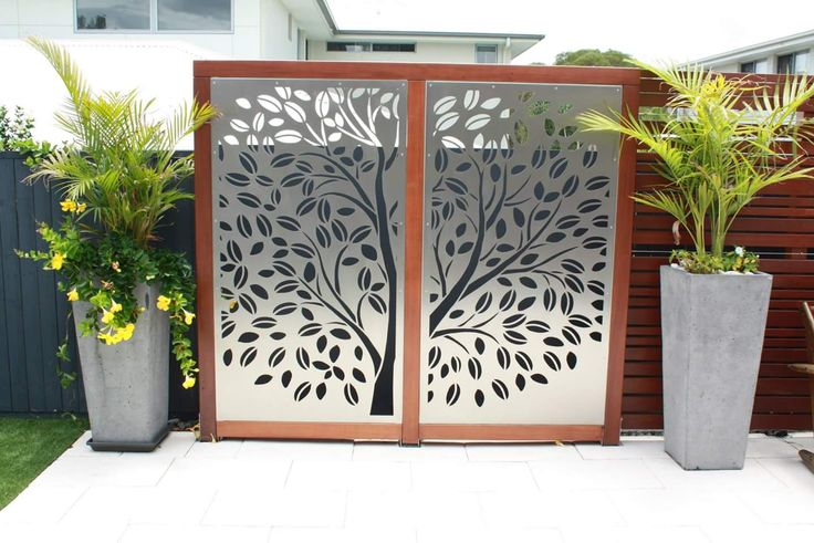 URBAN METAL : Outdoor Decorative Screens.  Stainless Steel + Timber - a match made in heaven !  Design : Tree Of Life Stainless Steel panels were custom framed in timber , creating a stunning combination. Urban Metal . Decorative Screening. Privacy Screens. Light Feature.