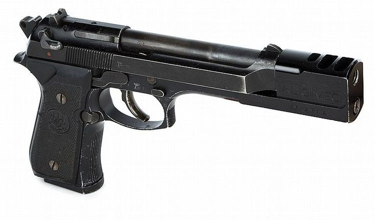Beretta 92 with comp used by Jean Reno in LeonFind our speedloader now! http://www.amazon.com/shops/raeind