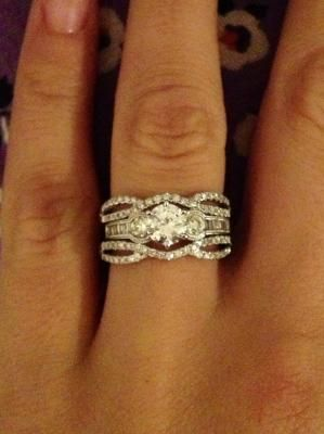 User submitted photo- solitaire in a dainty ring guard from zales