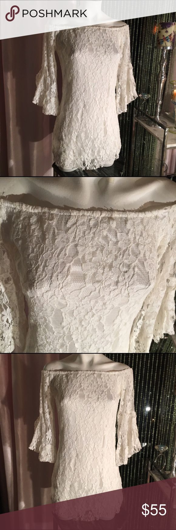 🥀Sizzling sexy white dress🥀 🥀This dress is so pretty and comfortable, white off the shoulder with Bell sheer sleeves. The bodice is all lined. I am always cold so I love the longer sleeves for clubs. Super sexy. Excellent condition Dresses Mini