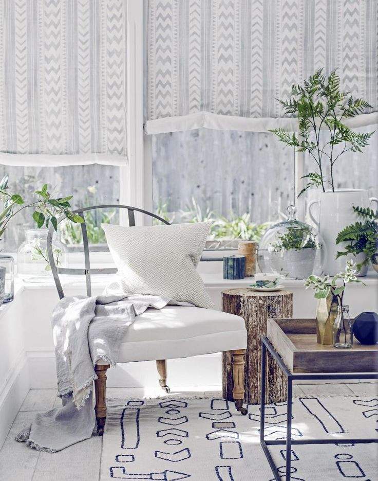White Modern Conservatory with Wrought-iron Chair and Coffee Table