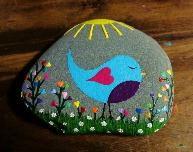 Stone painting of pretty blue bird