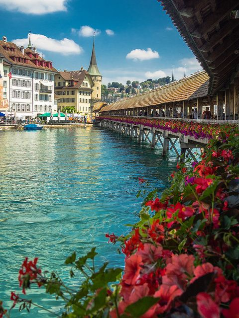 Chapel Bridge, Lucerne, Switzerland. Another lovely place, with beautiful bridge, with all paintings on the inside of the roof.