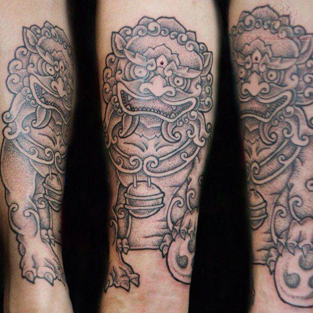 Foo Dog Ball Tattoo On Arm