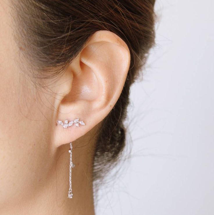 Stunning, uniquely designed, two way earringsThese earrings are made using sterling silver with clear cubic zirconia. In silver colour or plated with rose gold. They can be worn with the long hanging or just worn as a pair of ear studs. A unique and contemporary piece of jewellery suitable for both everyday and evening wear. This item comes in a stylish jewellery box and makes a gorgeous gift for any occasion - Mother's Day or Valentine's Day, a present for bridesmaids or birthdays...100%…