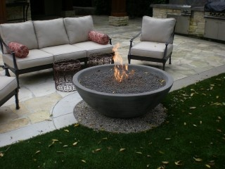 firebowl positioned btwn grass and stone area on pea gravel