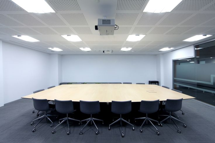 CMS installed in-desk power solutions in this boardroom space.