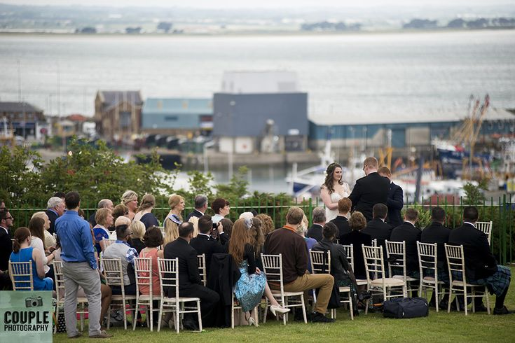 A view of the amazing outdoor wedding ceremony on the top of Howth. Wedding in The Abbey Tavern, Howth. Photographed by Couple Photography.