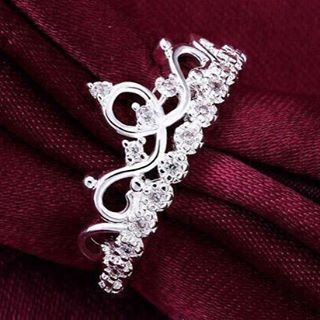 Princess-perfect, this diamond fashion ring is designed to delight. Its charming tiara-shaped ring features intricate scrolled detailing and a scattering of ...