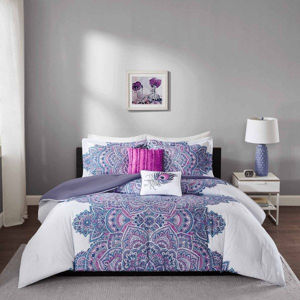 Katarina Comforter Set provides an eye-catching update to your bedroom. The textured ground has small grey circles on a white base creating dimension on the solid base. The floral medallion motif runs