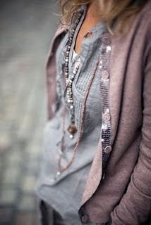 Beauty is in the details. The subtle sequins on the sweater and the necklaces.