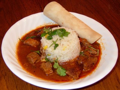 This TexMex beef stew recipe was adapted from the recipe used by Sylvias Enchilada Kitchen, a popular Houston restaurant.  I add one chopped jalapeno pepper with the green bell pepper (not listed below), and serve it with a mound of mexican rice (like #41167) in the bowl.