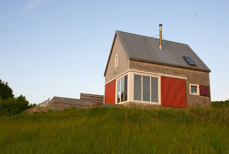 The Cape Breton landscape is dotted with small gable roofed houses, often shingled and with minimal roof overhangs. The Sea and Sky Cottage was designed by architect Craig Applegath and artist Stew...
