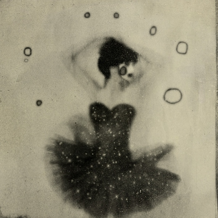 I am in love with a new photographer. Her name is Rimel Neffati, and she is a terrifying French woman. Her photos are surrealist black and ...
