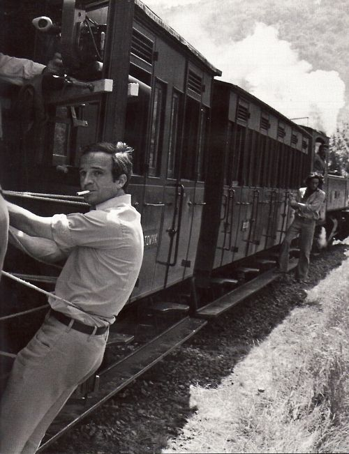 François Truffaut (hanging off a train) on the set of Les Deux Anglaises Et Le Continent (Two English Girls), 1971. http://semioticas1.blogspot.com.br/2011/11/cahiers-du-cinema.html .