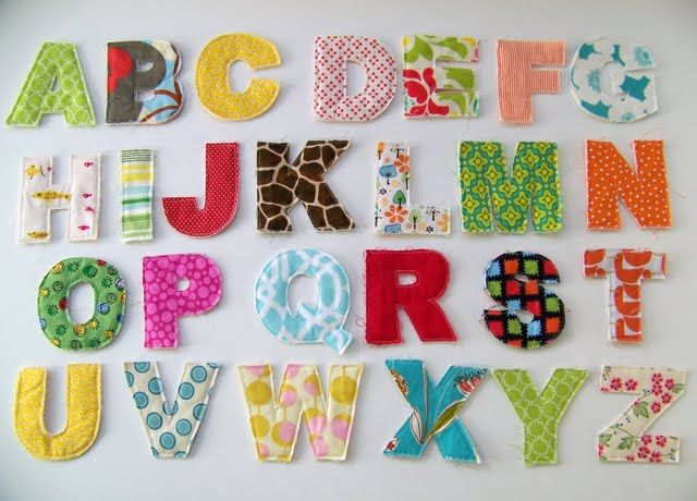 A way to use my left over scraps of fabric. Maybe I'll do the kids' names and hang them on the wall:
