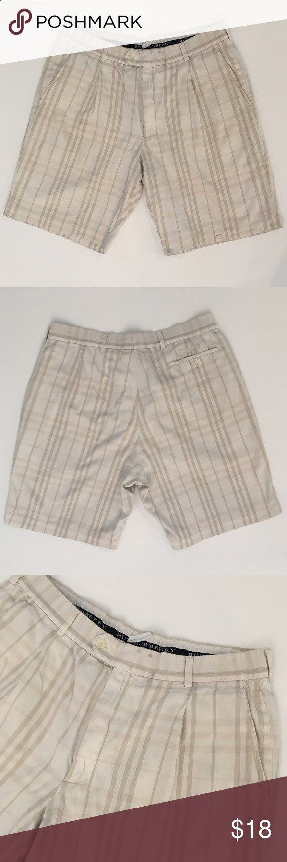 Burberry Golf Shorts Burberry Golf shorts with a light plaid print. They are worn. Please see photos. Minor spots and has belt marks. The hem on the bottom front left is being held by a safety pin it just needs to be sewn. Burberry Shorts