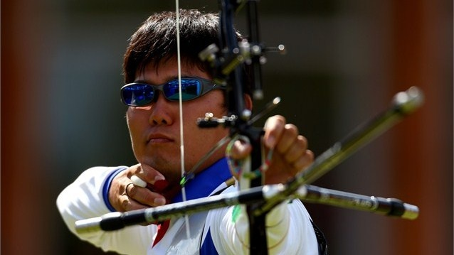 Takaharu Furukawa of Japan in men's Individual Archery.  Takaharu Furukawa of Japan defeats Rick Van Der Ven of Netherlands during the men's Individual Archery Semifinal match on Day 7 of the London 2012 Olympic Games at Lord's Cricket Ground.  /Photo/sport/General/01/32/23/581takaharu-furukawa-japan-competes1322358  Related tags