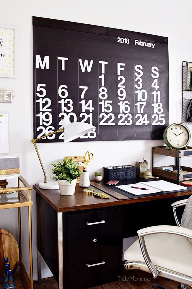 Decorating a shared home office, with colorful industrial style. Her side is pink and gold, while his is black and neutrals. Check out the gold coffee cart and Stendig wall calendar!! Get all the details of this shared home office space at TidyMom.net