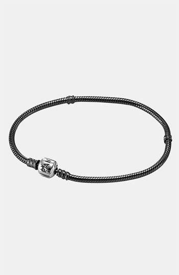 A sleek, oxidized bracelet features a threaded design that keeps charms secure. The logo-etched clasp makes a signature finish. Color(s): oxidized sterling silver. Brand: PANDORA. Style... More Details