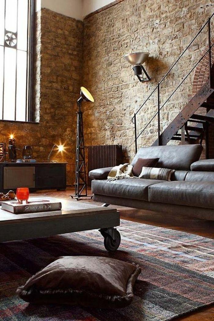 joli salon avec mur en fausse pierre dans le salon d'esprit loft
