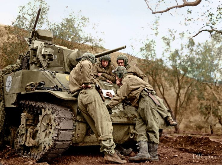 #WW2ColourisedPhotos ... US Lt. George H. Spires, Brooklyn, N.Y., going over a battle map with members of his M5A1 Stuart tank crew of the 757th Tank Battalion, while waiting for orders to move up. Mount Porchia, Italy. January 7, 1944   (L to R) Cpl. Thomas S. Davies, Wilkes Barre, Pa.; T/4 Guy Anthony, Cherryville, Nth Carolina, T/5 Herbret R. Dixon, Amory, Miss., and Lt. Spires.   (Photo source - US Signal Corps MM-5-152269)  (Colourised today by Doug)