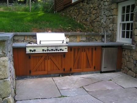 Outdoor kitchen with wooden cabinets for the home for Cedar outdoor kitchen cabinets
