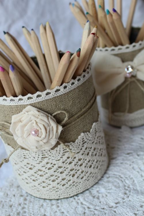 Like the burlap, lace and handmade flowers. Idea - alter tin cans or containers for holding stationery and stuff.