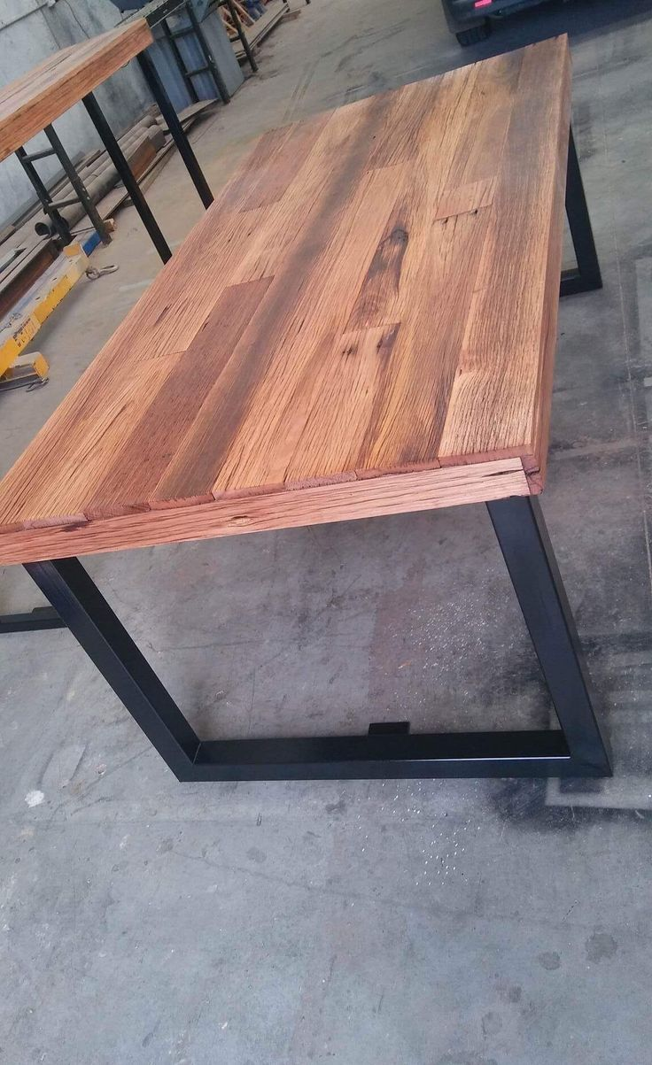 Recycled Timber palings industrial dining table with black metal legs