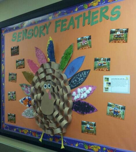 Toddlers created sensory feathers for our chain link turkey!