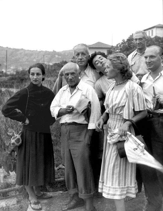 Pablo Picasso with Françoise Gillot and his friends by Willy Ronis, 1950