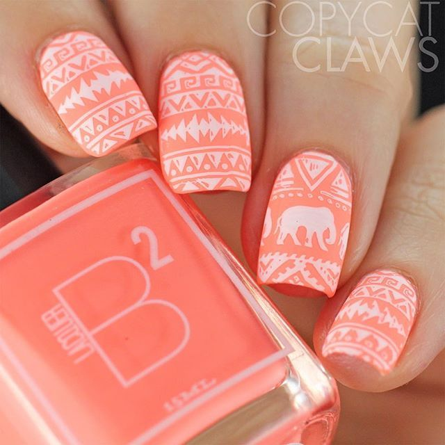 Great color combo in this tribal print nail art, including elephant.  This week #40greatnailartideas is doing coral/white nails and I got the personal prompt of stamped.  I kept it super simple with this @bundlemonster BM-XL202 stamping over @bsquaredlacquer Trance.  Thank you @chitchatnails for designing such a great tribal plate!  #40gnai