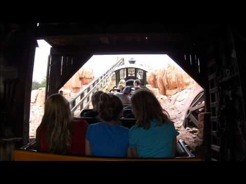 """VIDEO of Big Thunder Mountain Railroad at Magic Kingdom! TIP: The front cart is usually the best choice for coasters, but not this one...the back carts of the """"train"""" whip around a little faster and experience a wilder ride. You might slide from side to side in the cart, so make sure the little ones are in the middle."""