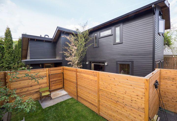 Small Portland home with black-painted cedar exterior