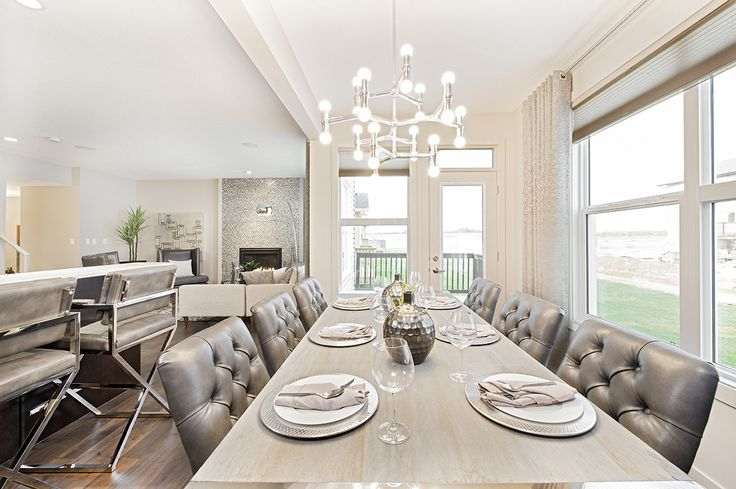 Dine in luxury and comfort with the monochromatic colour pallet of Jayman MasterBUILTs Allure<br></a>showhome in Secord, Edmonton. Though the colours of this space are closely related, the use of contrasting<br/>textures makes every element stand out, from the rustic wood table to the<br/>window treatments from Wen-Di by Jayman.