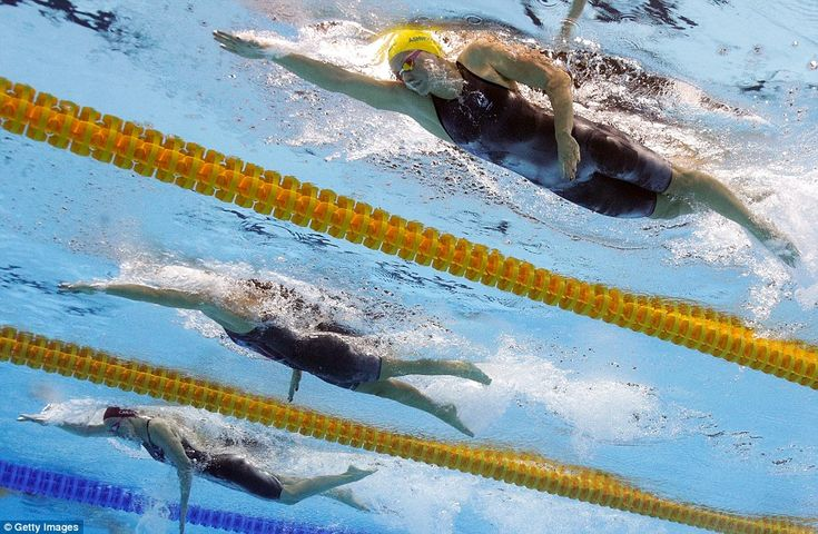 Jazz Carlin of Great Britain (left) came in second and Leah Smith of the United…